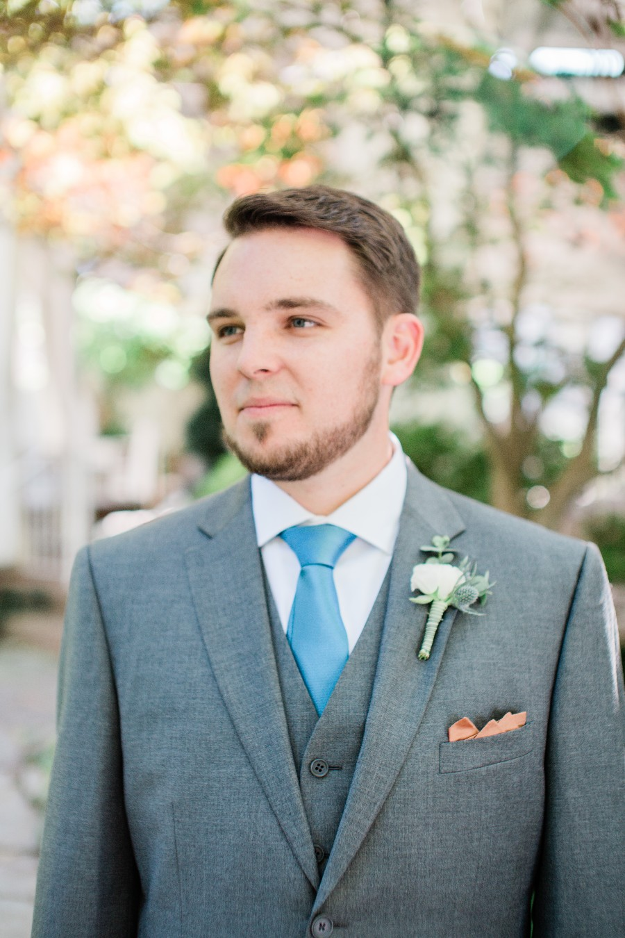 Groom in grey suite with blue tie