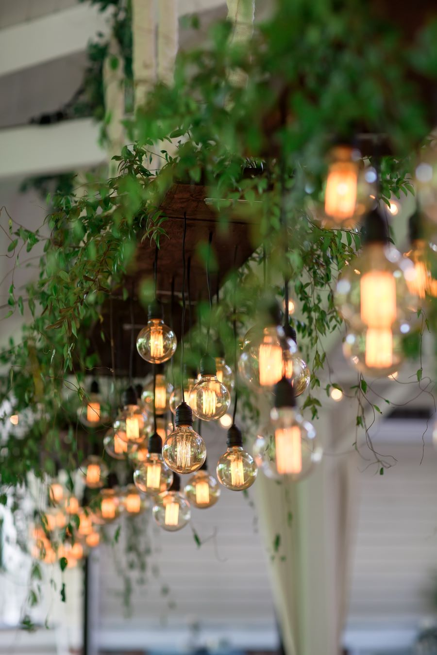 Close up of Edison bulb hanging lights above reception tables / Traditional / Spring / May / Baby Blue / Blush / Black